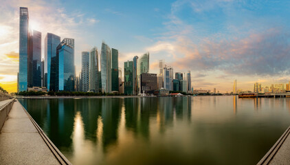 Singapore financial district skyline at Marina bay on sun set time, Singapore city, South east asia.