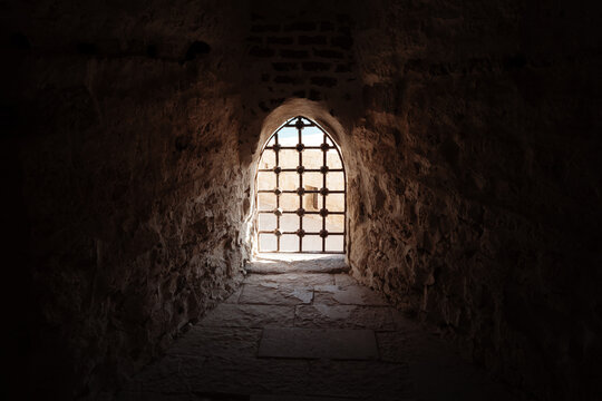 Window with bars in the old fortress