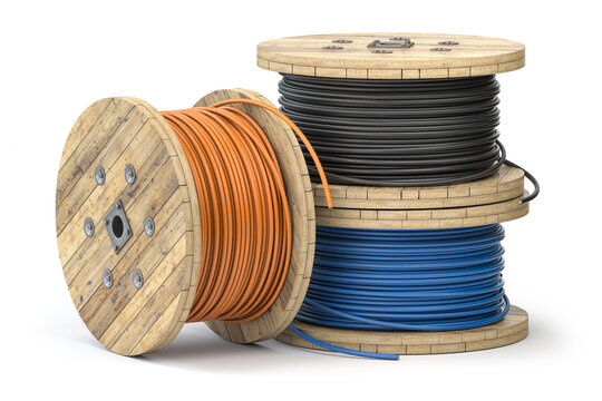Wire electric cable of different colors on wooden coil or spool isolated on white background.