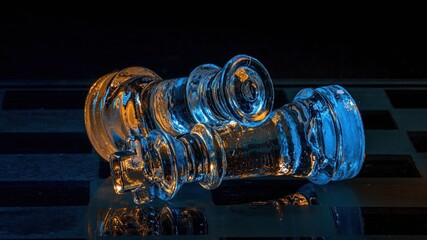 Fototapeta Szklane figury szachowe podświetlone światłem rgb makro obraz