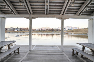 Fototapeta Coastal shelter with picnic tables overlooking the lake obraz