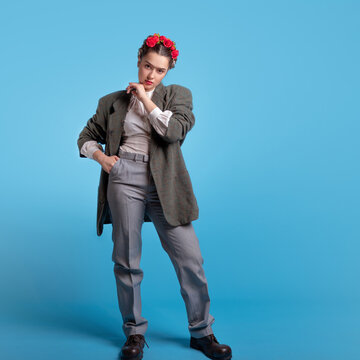 A young woman in a men's suit, gender neutral style.