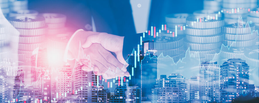 Double exposure - close up Businessman handshake to business partner and trade agreements and deals in urban center, business negotiations and trade,blurred background,Banner header panoramic