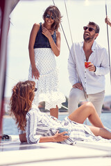 Obraz Group of classy rich friends cruising together; Luxurious lifestyle concept - fototapety do salonu