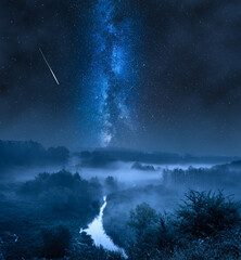 Obraz Foggy valley at night with milky way and stars. - fototapety do salonu