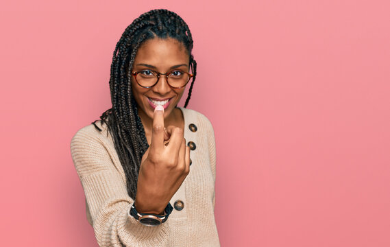 African american woman wearing casual clothes beckoning come here gesture with hand inviting welcoming happy and smiling