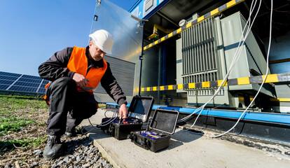 Fototapeta Execution of electrical measuring works on the power transformer obraz