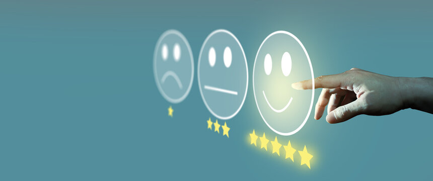 Businessman giving rating with smiley face emoticon on virtual touch screen, Customer satisfaction survey and Customer service evaluation concept.