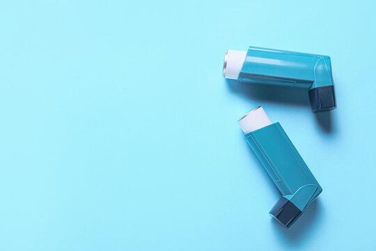 Modern inhalers on color background