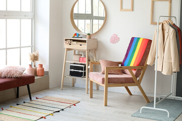 Obraz Armchair with flag of LGBT in interior of dressing room - fototapety do salonu
