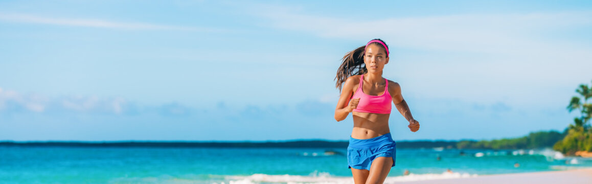 Running athlete woman exercising on beach run jogging healthy active lifestyle panoramic banner of fit girl training.