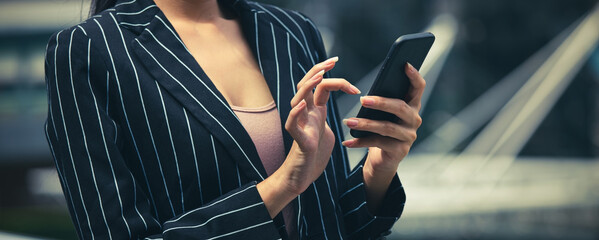 Banner of  Businesswoman hand with smartphone for work and  paying  debt of bill in the office - fototapety na wymiar