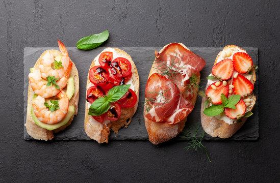 Appetizers plate with traditional spanish tapas set. Italian antipasti brushetta snacks
