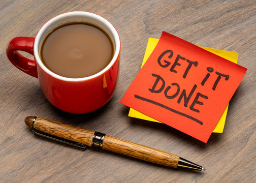 get it done advice or reminder handwriting on a sticky note with a cup of coffee, business, productivity and personal development concept