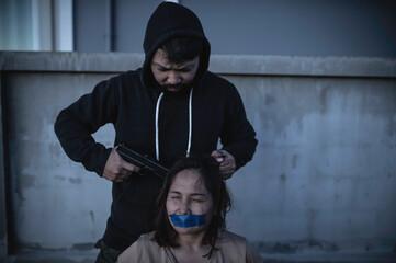 Obraz Businesswoman is hostage from bandit, Hostage of terrorist man concept, Thailand people - fototapety do salonu