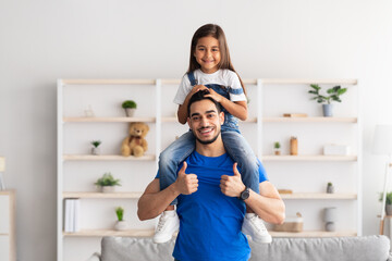 Cheerful Man Riding Excited Daughter On His Shoulders - fototapety na wymiar