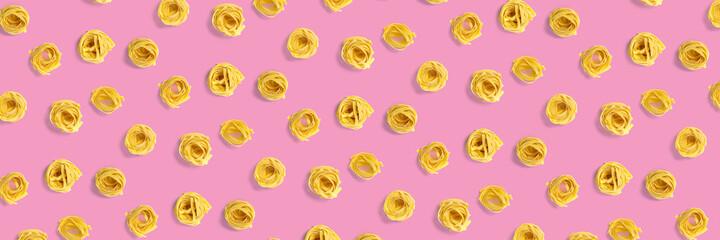 background from Italian tagliatelle pasta. raw pasta fettuccine, pop art background, flat lay....