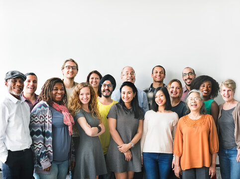 A team of diverse people doing a group photo
