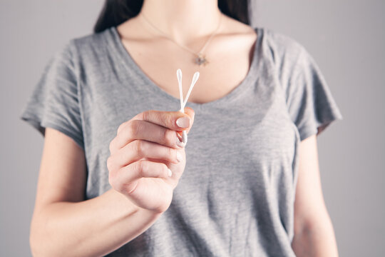 young girl holding cotton swabs