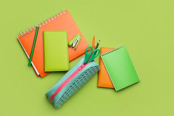 Obraz Pencil case and stationery on color background - fototapety do salonu