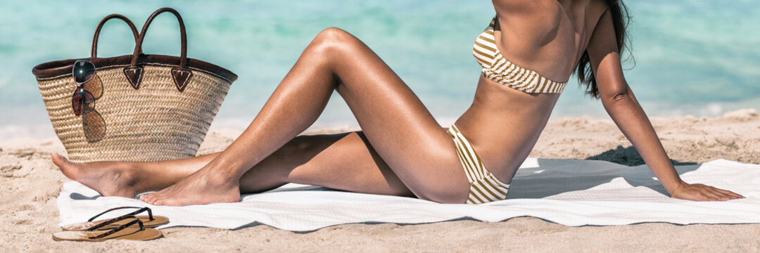 Beach suntan bikini body woman sunbathing banner panoramic crop on summer travel holiday.