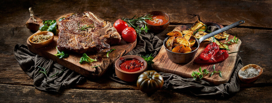 Grilled meat and vegetables with salt and sauces
