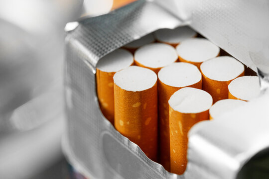 Opened new pack of cigarettes close up