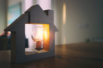 Fototapeta Wood house with Light bulb. energy concept or invention obraz