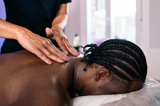 Relaxed African Man Receiving Massage