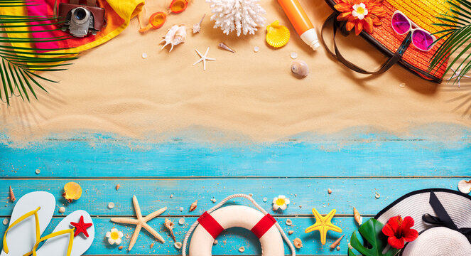 Beach Accessories On Tropical Sand And Wooden Table
