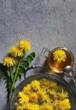 Yellow dandelions and jar of honey