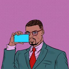 Fototapeta african businessman shoots video on smartphone obraz