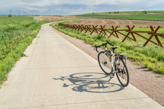 touring bicycle in early summer on a bike trail between Loveland and Fort Collins in northern Colorado, recreation and commuting concept