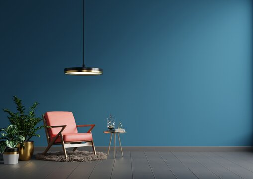 Interior wall mockup in blue tones with red leather armchair on dark wall background.