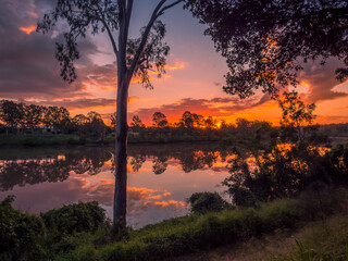 Spectacular Riverside Sunset with Cloud Reflections