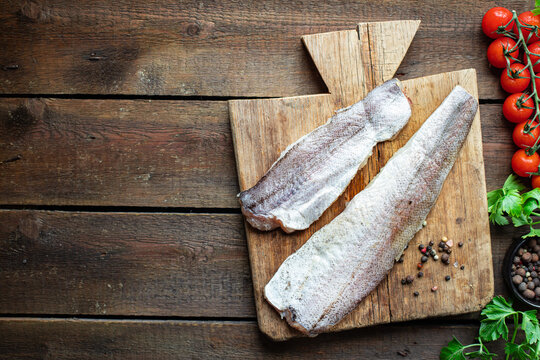 hake fresh pangasius fish seafood ingredient on the table healthy food meal copy space food background rustic top