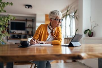 Fototapeta Senior businesswoman, working hard, from home office. obraz