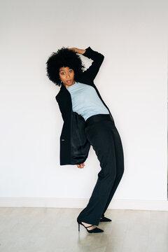 Surprised stylish black woman in elegant suit