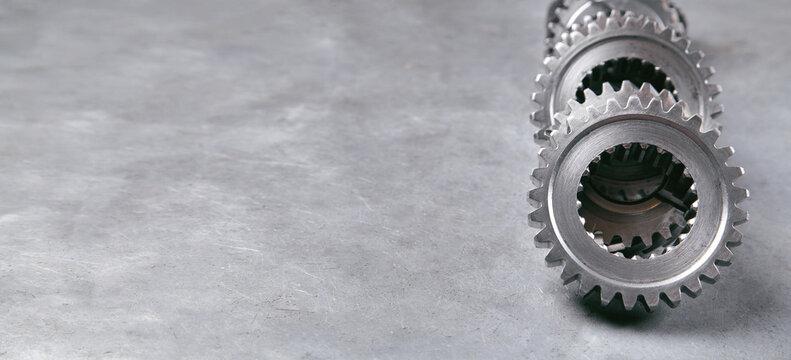 Gears mechanism on metal background. Industry