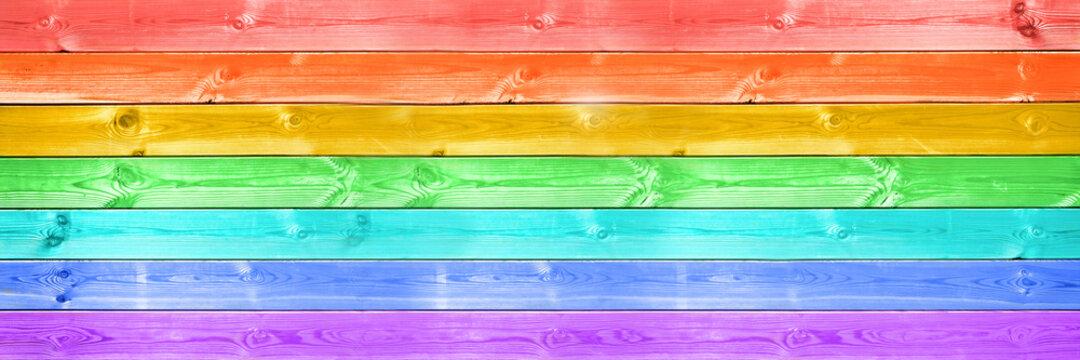 Pastel colorful rainbow painted wood planks panoramic background. Rainbow flag, LGBTQ pride web banner