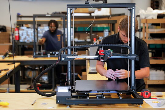 3D Printer Assembly Team Members Kaome O'Faire and Ian Jaffe work at gCreate, a 3D printer manufacturer, in New York City