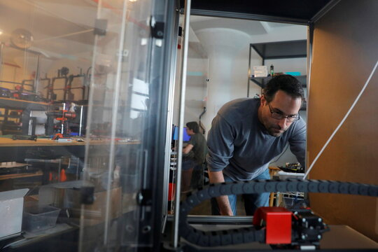 Co-founder and Co-CEO Gordon LaPlante works on a 3D printer enclosure prototype at gCreate, a 3D printer manufacturer, in New York City