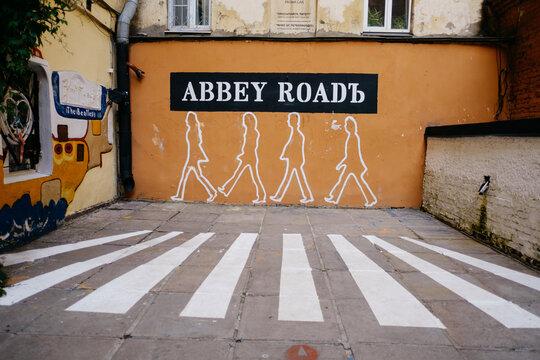Saint-Petersburg, Russia, 08 September 2020: John Lennon Street, street dedicated to The Beatles, modern monument. Art-Center 'Pushkinskaya 10'. Wall with graffiti 'Abbey Road'.