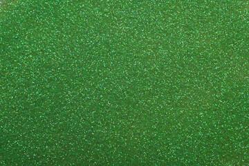 Beautiful shiny green glitter as background, closeup