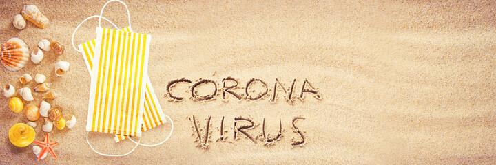 Obraz Corona virus written in the sand on vacation - fototapety do salonu