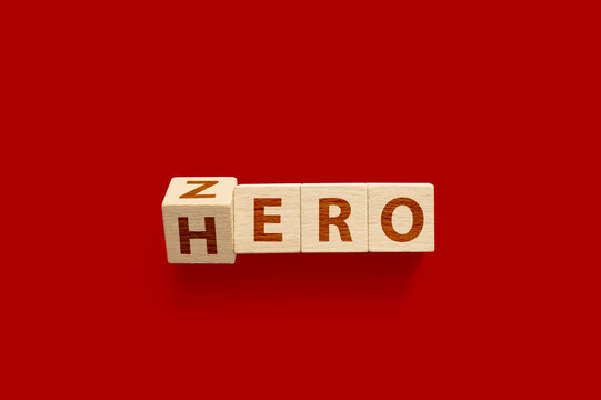 Zero or Hero concept, Wooden cube flip change the word on red background