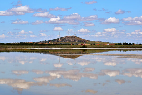 Reflections in the lake. Mountain and clouds reflected in the water of the lagoon of the Natural Reserve of the Lagunas de El Longar, located in Lillo, town of Toledo, in Spain