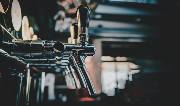many beer taps in bar or pub