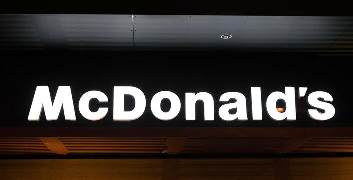Kyiv, Ukraine - 05 Fabruary 2021: Signboard of McDonalds restaurant with neon light. Closeup view of mc logotype
