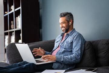 Fototapeta Mixed race businessman on video call in smart working obraz